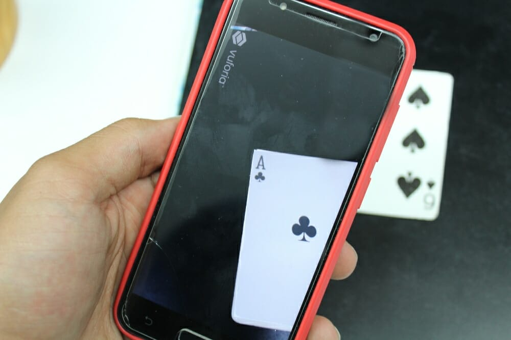 Phone with Ace of Clubs on screen