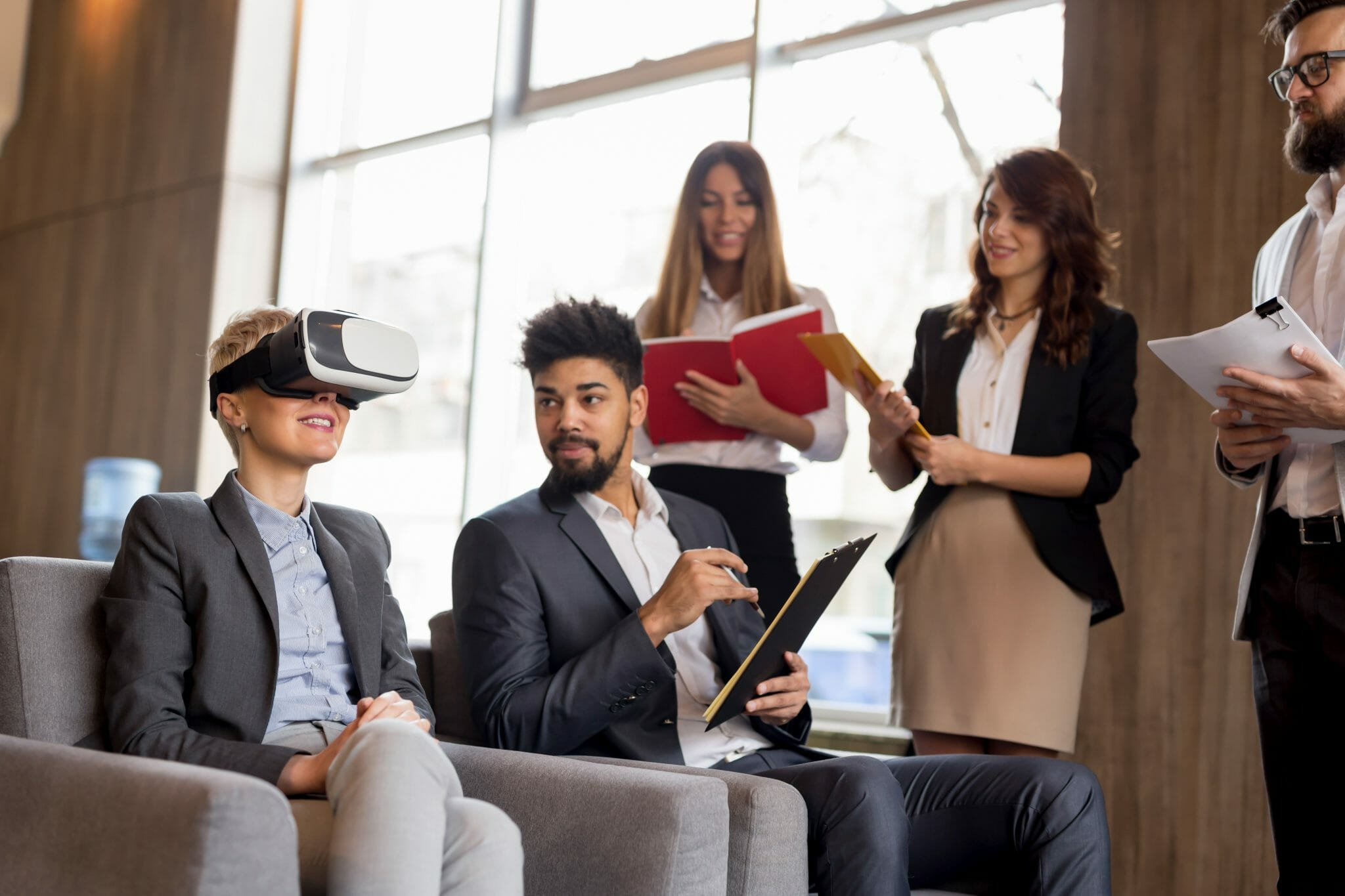 Group of people watching a coworkers VR demonstration